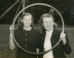 Two Bryn Mawr students on May Day 1949 looking through a May Day hoop