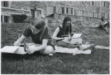Students work on typewriters outside