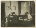 Two students reading in a dorm