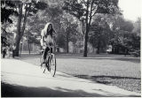 Student biking on path from Erdman to Merion Ave.