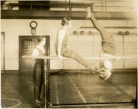 Students on parallel bars