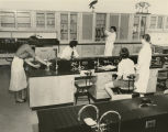 Students and professor in chemistry laboratory