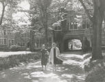 Students walking along the path from Pembroke Arch to the main college ground