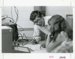 Al Albano with student in the Park Science Center's Physics Lab