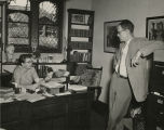 Agnes Kirsopp Lake Michels with Professor Howard Comfort (Haverford College) in her Thomas Library...