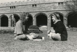 Kim Kline, Class of 1986 (on left) and Nicole B. Nothman, Class of 1988, sitting on the grass in...