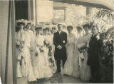 Wedding photo (?) with 8 women, 2 men