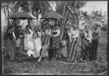 A Moro datu with his wife and retinue.