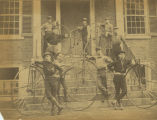 Students at the side entrance to Founders Hall with bicycles
