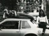 Pair of Students on Car