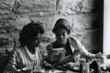 Two Female Students of Color Reading Baldwin