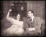 The Philadelphia Story: Katharine Hepburn (holding watch) as Tracy Lord and Joseph Cotten as...
