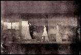 Jane Eyre: Wide view of set for Moor House, including Katharine Hepburn looking out the door