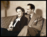 Publicity portrait of Fredric March and Florence Eldridge, seated on a sofa