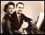 Publicity portrait of Fredric March and Florence Eldridge, seated at a piano, looking at camera