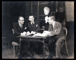 Rouben Mamoulian, Oscar Hammerstein, Theresa Helburn, and Richard Rodgers work together on stage