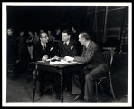 Oscar Hammerstein (librettist/lyricist) and Richard Rodgers (composer) work with Rouben Mamoulian...