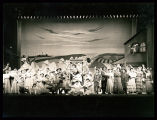 Oklahoma!: Full-stage view of cast in finale, featuring Wilton Clary as Curly and Carolyn Tanner...