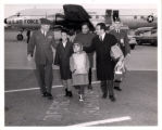 [untitled item; photo of Viet children and adults outside of airplane]