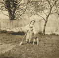 Little boy, dog, hammock