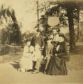 Group portrait on bench in garden